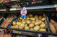 Best of British, fresh produce on supermarket shelving