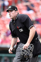 Home plate umpire Chris Conroy watches a play during a game between the Charlotte Knights and Buffalo Bisons at Dunn Tire Park on May 22, 2011 in Buffalo, New York.  Buffalo defeated Charlotte by the score of 7-5.  (Mike Janes/Four Seam Images)
