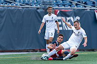 FOXBOROUGH, MA - JULY 25: USL League One (United Soccer League) match. Collin Verfurth #35 of New England Revolution II tackles Ethan Vanacore-Decker #7 of Union Omaha during a game between Union Omaha and New England Revolution II at Gillette Stadium on July 25, 2020 in Foxborough, Massachusetts.