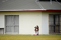 A parent photographs the Secondary School Boys' First XI Cup national cricket finals match between Otago Boys' High School and Rosmini College at Manawaroa Park in Palmerston North, New Zealand on Friday, 8 December 2017. Photo: Dave Lintott / lintottphoto.co.nz