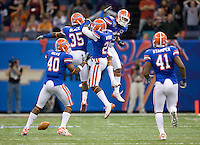 01 January 2010:  Florida teammates' Ahmad Black, Major Wright and Joe Haden celebrate in the air after making a huge play during the game against Cincinnati during Sugar Bowl at the SuperDome in New Orleans, Louisiana.  Florida defeated Cincinnati, 51-24.