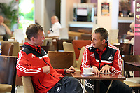 Wednesday 07 August 2013<br /> Pictured L-R: Assistant manager Morten Wieghorst and scout Erik Larsen at Cardiff Airport.<br /> Re: Swansea City FC travelling to Sweden for their Europa League 3rd Qualifying Round, Second Leg game against Malmo.