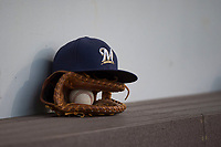 An AZL Brewers hat rests on a glove during an Arizona League game against the AZL Cubs 1 at Sloan Park on June 29, 2018 in Mesa, Arizona. The AZL Cubs 1 defeated the AZL Brewers 7-1. (Zachary Lucy/Four Seam Images)