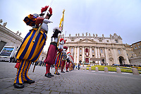 Swiss Guards stand attention as they wait for Pope Francis to preside over Easter Mass in St. Peter's Square at the Vatican, Sunday, April 21, 2019.