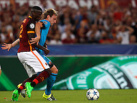 Calcio, Champions League, Gruppo E: Roma vs Barcellona. Roma, stadio Olimpico, 16 settembre 2015.<br /> Roma's Antonio Ruediger, left, and FC Barcelona's Ivan Rakitic fight for the ball during a Champions League, Group E football match between Roma and FC Barcelona, at Rome's Olympic stadium, 16 September 2015.<br /> UPDATE IMAGES PRESS/Riccardo De Luca