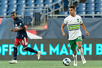 FOXBOROUGH, MA - AUGUST 26: Noah Pilato #20 of Greenville Triumph SC dribbles during a game between Greenville Triumph SC and New England Revolution II at Gillette Stadium on August 26, 2020 in Foxborough, Massachusetts.