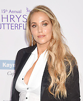 BRENTWOOD, CA - JUNE 11: Actress Elizabeth Berkley arrives at the 15th Annual Chrysalis Butterfly Ball at a private residence on June 11, 2016 in Brentwood, California.