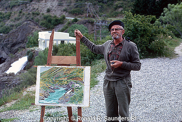 Painter stands alongside his painting of the Roaring Meg, a hydro electricity power station.