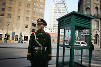 CHINA. Shanghai. A soldier stands guard near the Bund. Shanghai is a sprawling metropolis or 15 million people situated in south-east China. It is regarded as the country's showcase in development and modernity in modern China. This rapid development and modernization, never seen before on such a scale has however spawned countless environmental and social problems. 2008.