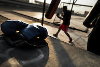 A Peruvian youth trains with a punching bag at the Boxeo VMT boxing club in an outdoor gym in Lima, Peru, 2 April 2013. Boxeo VMT is a grassroots organisation offering boxing lessons to youth as an alternative to gang violence, crime and drug-trafficking. Located in some of Lima's most marginalized neighborhoods, Boxeo VMT club joins nearly 50 young men. Although the club disposes only of an unequipped outdoor facility with couple of punching bags, the young boxers train hard three times a week and dream to become a boxing champion.