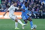 Getafe CF's Djene Dakoman (r) and Real Madrid's Dani Carvajal during La Liga match. January 4,2020. (ALTERPHOTOS/Acero)