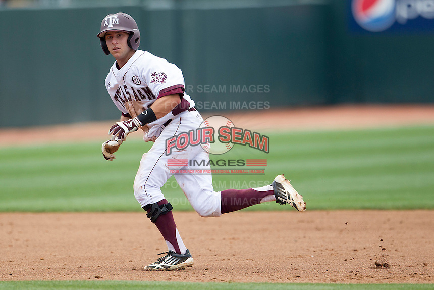 Texas A&M Aggies shortstop Mikey Reynolds (16) runs to third base against the LSU Tigers in the NCAA Southeastern Conference baseball game on May 11, 2013 at Blue Bell Park in College Station, Texas. LSU defeated Texas A&M 2-1 in extra innings to capture the SEC West Championship. (Andrew Woolley/Four Seam Images).