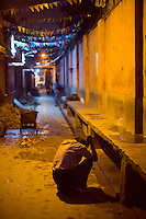 A distressed man outside the Fatepuri night shelter for the homeless in Old Delhi.