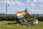 Swansea, UK, 11th May 2020.<br />Rainbow flag on the now overgrown floral boat display off the seafront in Mumbles, Swansea this morning as the devolved Welsh government continue to ask people in Wales to stay at home due to the Coronavirus pandemic.