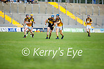 Dr Crokes Declan Hickey and Adam Maunsell of Abbeydorney tussle for possession in the County Senior hurling championship game on Sunday