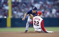 Omar Vizquel of the Cleveland Indians waits for the throw during a 2002 MLB season game as David Eckstein of the Los Angeles Angels slides into second base at Angel Stadium, in Los Angeles, California. (Larry Goren/Four Seam Images)
