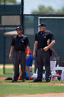 Umpires Chris Argueza (left) and Chad Patterson (right) during a Gulf Coast League game between the GCL Yankees East and GCL Phillies West on August 3, 2019 at the Carpenter Complex in Clearwater, Florida.  The GCL Phillies West defeated the GCL Yankees East 15-7 in a completion of a game that was originally started on July 26, 2019.  (Mike Janes/Four Seam Images)