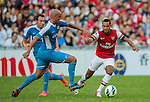 Theo Walcott of Arsenal FC and Zeshan Rehman of Kitchee in action during the pre-season Asian Tour friendly match at the Hong Kong Stadium on July 29, 2012. Photo by Victor Fraile / The Power of Sport Images
