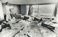1978<br />  FILE PHOTO - ARCHIVES -<br /> <br /> Waves drive huge cakes of ice into one of lounges at Boulevard Club on Lake Shore Blvd. as Ted Krawec - ironically; ice-maker for the club's curling rink - tries to clear ice away. Water was 6 feet deep over much of the premises during height of yesterday's storm. Damage is estimated at more than $100;000. The sauna room; pro shop; lockers; laundry room . . . they're all gone; said another worker . . . worse than Hurricane Hazel.<br /> <br /> Bezant, Graham<br /> Picture, 1978<br /> <br /> 1978<br /> <br /> PHOTO : Graham Bezant - Toronto Star Archives - AQP