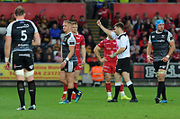 Hanno Dirksen of Ospreys  is shown a yellow card by Referee Ben Whitehouse during the Guinness Champions Cup play-off match between the Ospreys and Scarlets at the Liberty Stadium in Swansea, Wales, UK.  Saturday 18 May 2019