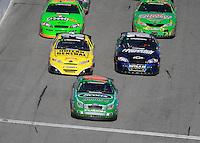 Feb 14, 2009; Daytona Beach, FL, USA; NASCAR Nationwide Series driver Carl Edwards (60) leads Brian Vickers (32) and Tony Stewart (80) during the Camping World 300 at Daytona International Speedway. Mandatory Credit: Mark J. Rebilas-