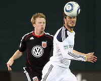 Dax McCarty (10) of D.C. United runs up to David Beckham (23) of the Los Angeles Galaxy during an MLS match at RFK Stadium, on April 9 2011, in Washington D.C.The game ended in a 1-1 tie.
