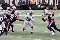 27th September 2020, Foxborough, New England, USA;  Las Vegas Raiders running back Josh Jacobs (28) runs into New England Patriots defensive lineman Deatrich Wise Jr. (91) during the game between the New England Patriots and the Las Vegas Raiders