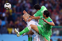 Michael Bradley (L) of USA battles for the ball with Rafik Halliche (centre) and Anther Yahia (right) of Algeria. USA defeated Algeria 1-0 in stoppage time in the 2010 FIFA World Cup at Loftus Versfeld Stadium in Pretoria, Sourth Africa, on June 23th, 2010.