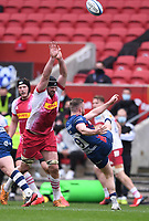 27th March 2021; Ashton Gate Stadium, Bristol, England; Premiership Rugby Union, Bristol Bears versus Harlequins; Andy Uren of Bristol Bears kicks under pressure from Matt Symons of Harlequins