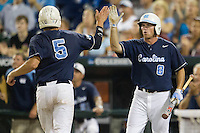 North Carolina outfielder Parks Jordan (8) greets teammate Michael Russell (5) as he scores during Game 10 of the 2013 Men's College World Series against the North Carolina State Wolfpack on June 20, 2013 at TD Ameritrade Park in Omaha, Nebraska. The Tar Heels defeated the Wolfpack 7-0, eliminating North Carolina State from the tournament. (Andrew Woolley/Four Seam Images)