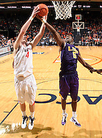 Jan. 2, 2011; Charlottesville, VA, USA; LSU Tigers forward Malcolm White (5) and Virginia Cavaliers forward Will Regan (4) fights for the rebound during the game at the John Paul Jones Arena. Virginia won 64-50. Mandatory Credit: Andrew Shurtleff-