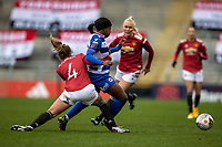 7th February 2021; Leigh Sports Village, Lancashire, England; Women's English Super League, Manchester United Women versus Reading Women; Amy Turner of Manchester United Women tackles Danielle Carter of Reading