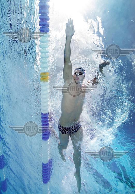 Alexander Dale Oen, Norwegian national swimming team training in an outdoor  pool. Frognerbadet, Oslo, Norway..© Fredrik Naumann/Felix Features