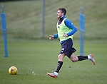 Andy Halliday kicking some ice from the grass