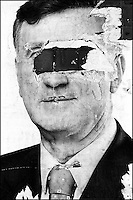 A street poster of a Macedonian presidential candidate Boris Trajkovski (now deceased) is gouged in the eyes. There are two million people residing in Macedonia, but an enormous rise in population among the Albanian population is contributing to the ethnic tensions and crimes between Albanians and Macedonians. Skopje, Macedonia, June 2000 © Stephen Blake Farrington<br />