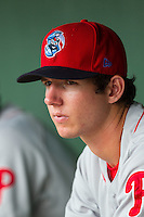 Matt Imhof (13) of the Lakewood BlueClaws watches the action from the dugout during the game against the Kannapolis Intimidators at CMC-NorthEast Stadium on July 20, 2014 in Kannapolis, North Carolina.  The Intimidators defeated the BlueClaws 7-6. (Brian Westerholt/Four Seam Images)