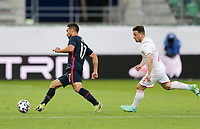 ST. GALLEN, SWITZERLAND - MAY 30: Sebastian Lletget #17  of the United States is chased down by Shaqiri #23 of Switzerland during a game between Switzerland and USMNT at Kybunpark on May 30, 2021 in St. Gallen, Switzerland.