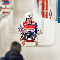 5 December 2015: Erin Hamlin, competing for the United States of America, is elated as she crosses the finish line of her second run of the Viessmann World Cup Women's Luge. With a combined 2-run time of 1:27.961, and a track record on her first run, Hamlin takes the first place finish at the Olympic Sports Track in Lake Placid, New York, USA. Mandatory Credit: Ed Wolfstein Photo *** RAW (NEF) Image File Available ***