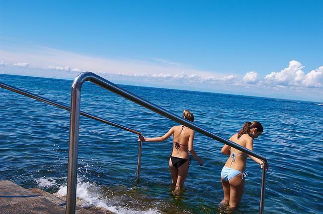 2 girls going into the sea for a swim , Slovenia
