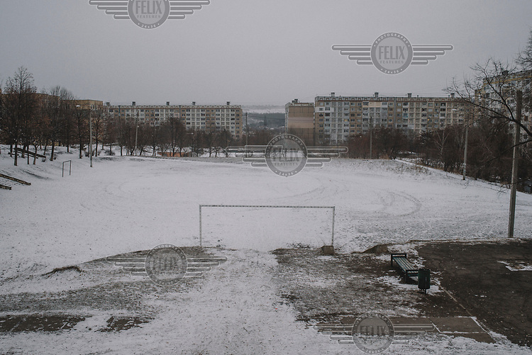 A snow covered a football pitch in the Ciocana district.