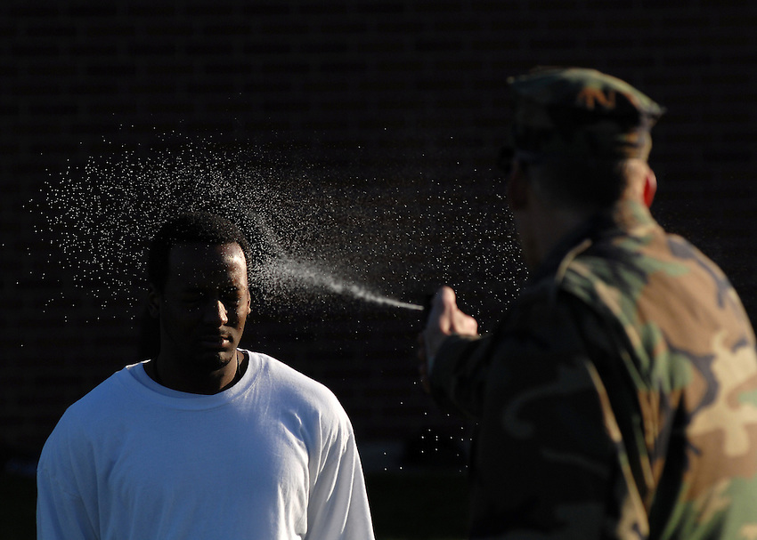 A Sailor is sprayed with Oleoresin Capsicum (Pepper) Spray during ship's security force training.