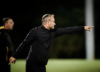 NWA Democrat-Gazette/CHARLIE KAIJO Arkansas Razorbacks head coach Colby Hale gestures to his players during a soccer game, Thursday, September 27, 2018 at Razorback Field in Fayetteville.