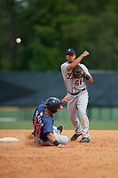 Detroit Tigers Anthony Pereira (68) throws to first base as Alejandro Salazar (34) slides into second base during a minor league Spring Training game against the Atlanta Braves on March 25, 2017 at the ESPN Wide World of Sports Complex in Orlando, Florida.  (Mike Janes/Four Seam Images)