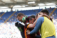 Calcio, Serie A: Lazio vs Roma. Roma, stadio Olimpico, 3 aprile 2016.<br /> Roma's Edin Dzeko, left, celebrates with teammates after scoring during the Italian Serie A football match between Lazio and Roma at Rome's Olympic stadium, 3 April 2016. Roma won 4-1.<br /> UPDATE IMAGES PRESS/Isabella Bonotto