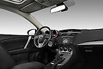 Passenger side low angle dashboard view of a 2010 Mazda 3 5-Door S Grand Touring