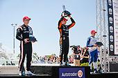 #5: Pato O'Ward, Arrow McLaren SP Chevrolet celebrates winning, #2: Josef Newgarden, Team Penske Chevrolet, #10: Alex Palou, Chip Ganassi Racing Honda