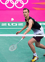 28 JUL 2012 - LONDON, GBR - Marc Zweibler (GER) of Germany returns  during his London 2012 Olympic Games men's singles group badminton match against Mohamed Ajfan Rasheed (MDV) of Moldova  at Wembley Arena, London, Great Britain .(PHOTO (C) 2012 NIGEL FARROW)