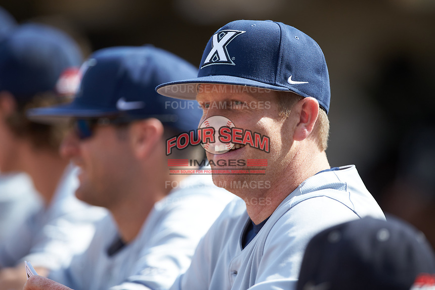 Xavier Musketeers volunteer assistant coach Kyle Sprague looks on from the dugout against the Penn State Nittany Lions at Coleman Field at the USA Baseball National Training Center on February 25, 2017 in Cary, North Carolina. The Musketeers defeated the Nittany Lions 10-4 in game one of a double header. (Brian Westerholt/Four Seam Images)