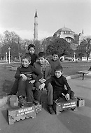 Children employed at shoe shine stand in Istanbul, Turkey - Child labor as seen around the world between 1979 and 1980 – Photographer Jean Pierre Laffont, touched by the suffering of child workers, chronicled their plight in 12 countries over the course of one year.  Laffont was awarded The World Press Award and Madeline Ross Award among many others for his work.