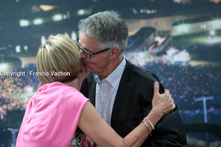Lucy Tremblay kisses Daniel Gelinas as he announce that he quits his job as Festival D'ete de Quebec (FEQ) General Manager in Quebec city Wednesday July 26, 2017.